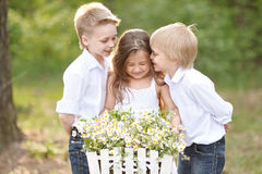 Three children playing on meadow Royalty Free Stock Image