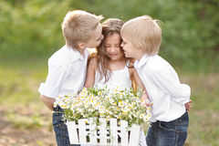 Three children playing on meadow Royalty Free Stock Photography