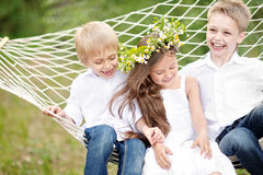 Three children playing on meadow Stock Photography