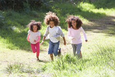 Three Children Playing In Woods Together Stock Photography