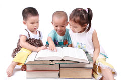 Three children reading Royalty Free Stock Image