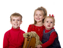 Three Children and Rocking Horse Stock Images