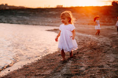 Three Children Running Along Beach Stock Photo