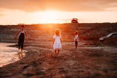 Three Children Running Along Beach Stock Photography