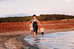 Three Children Running Along Beach Royalty Free Stock Photography