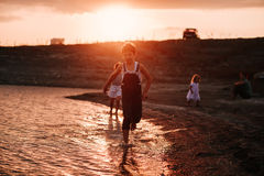 Three Children Running Along Beach Stock Image