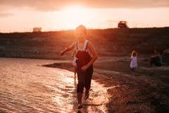 Three Children Running Along Beach Royalty Free Stock Photo