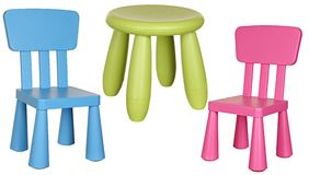 Three children's plastic chairs isolated on white Royalty Free Stock Photography