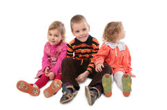 Three children sitting Stock Photography