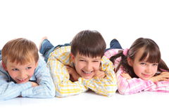Three children smiling Royalty Free Stock Photos