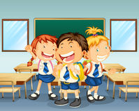Three children smiling inside the classroom Stock Photography