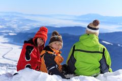 Three children in the snow Royalty Free Stock Photo