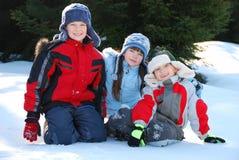 Three Children in Snow Stock Photos