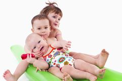 Three children in swimsuits Royalty Free Stock Photo