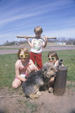 Three children with their dog Stock Images