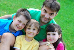 Three Children And Their Uncle Stock Photo