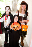 Three Children - Trick or Treat Stock Images