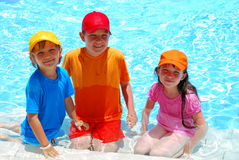 Three children in water Royalty Free Stock Photo