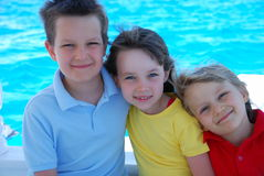 Three children on the water Royalty Free Stock Images