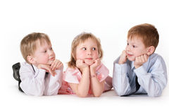 Three children on a white background Royalty Free Stock Image