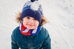 Three children in winter clothing walking stock images