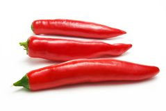 Three chili pepper isolated Stock Photography