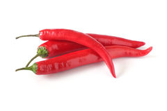 Three chili peppers  on white Royalty Free Stock Photography