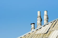 Three chimney on diagonal roof Stock Image