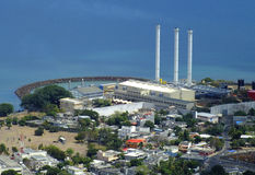 Three chimneys. Aerial view of a power station in Port-Louis, Mauritius with three chimneys with the sea in background Royalty Free Stock Image