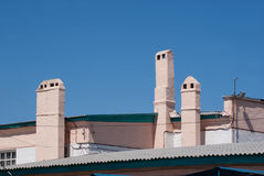 Three chimneys against the clear  blue sky Royalty Free Stock Photo
