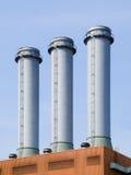Three chimneys and blue sky Royalty Free Stock Photos