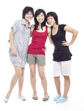 Three Chinese Asian teenager girl friends bonding. Three Chinese Asian teenager girl friends sharing a happy moment. Shot in studio isolated on white Royalty Free Stock Photos