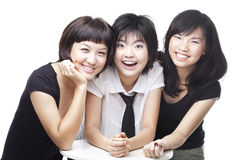 Three Chinese Asian teenager girl friends bonding. Three Chinese Asian teenager girl friends sharing a happy moment. Shot in studio isolated on white Royalty Free Stock Images