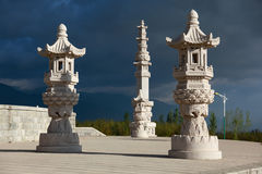 Three chinese style stone lantern. With dark cloud Royalty Free Stock Photos