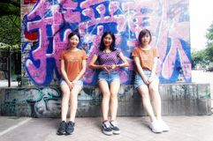 Three chinese woman posing against graffiti royalty free stock photos