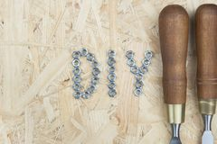 Three chisels on a wooden background. Professional chisels on a wood background. Visible wood grain Stock Images