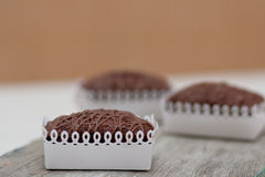 Three Chockolate Brownies On Wooden Kitchen Board Stock Photo