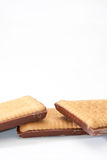 Three chocolate biscuits on a white background Royalty Free Stock Photo