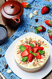 Three chocolate cake decorated with strawberries and mint leaves Royalty Free Stock Photos