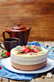 Three chocolate cake decorated with strawberries and mint leaves Stock Photography