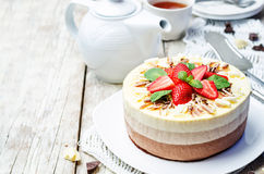 Three chocolate cake decorated with strawberries and mint leaves Stock Image