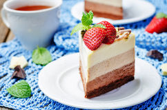 Three chocolate cake decorated with strawberries and mint leaves Stock Photos