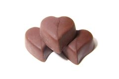 Three chocolate candy in the shape of heart. On white background Stock Images
