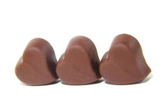 Three chocolate candy in the shape of heart. On white background Stock Photography