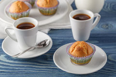 Three chocolate chip muffins on white plate and blue striped tab Stock Photos