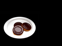 Three chocolate coated sponge biscuit with marmalade Stock Photography