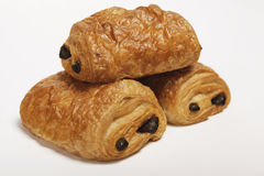 Three chocolate croissants close up. Three croissants with chocolate filling on a white background Stock Images