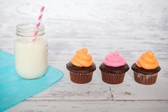 Cupcakes and milk Stock Photography