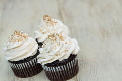 Three Chocolate Cupcakes With White Vanilla Frosting Royalty Free Stock Photo
