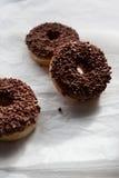 Three chocolate doughnuts Stock Images